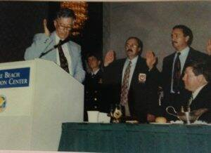 Robbie Robertson swearing in officers during the 1996 annual conference